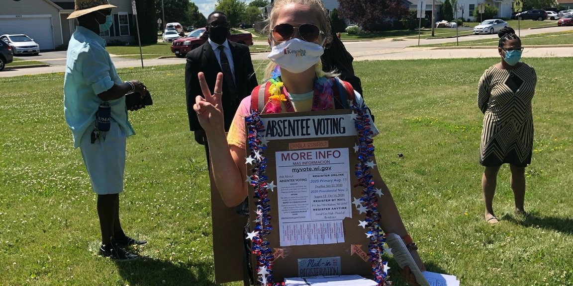 Person with a Register to Vote sign board Kenosha July 2020.jpeg