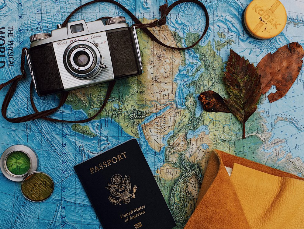 Travel map, passport, camera, keepsakes